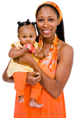 Mid adult woman carrying daughter