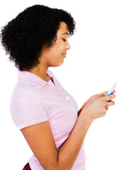 Happy teenage girl text messaging