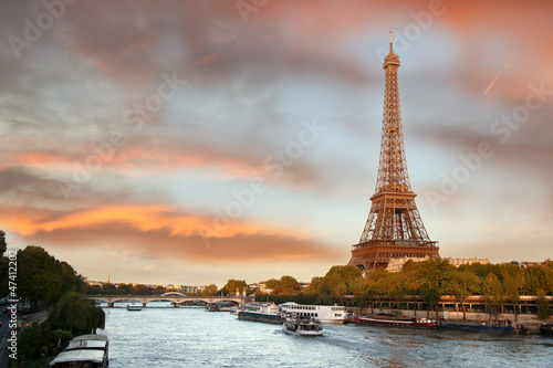 Eiffel Tower  with boats on Siene in  Paris, France