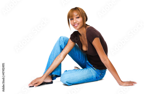 Happy woman sitting on floor