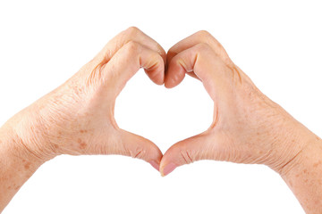 woman senior hands show heart gesture, isolated