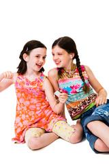Happy girls listening MP3