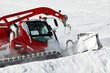 .Snow-grooming machine on snow hill