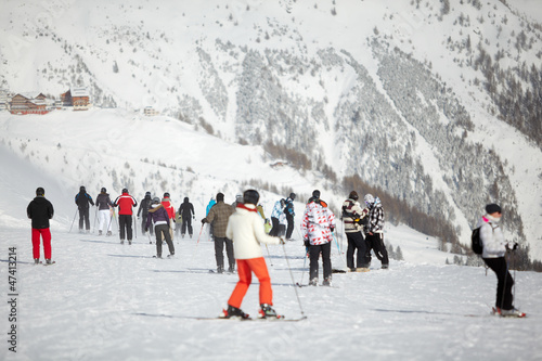 Group of skiers on snowy hillslope