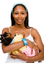 Happy woman carrying her daughter