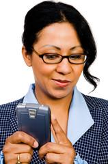 Happy businesswoman text messaging