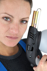 Woman holding a blowtorch