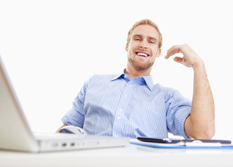 young man at office smiling