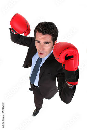 Successful businessman with boxing gloves