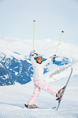 Happy little girl skiing downhill