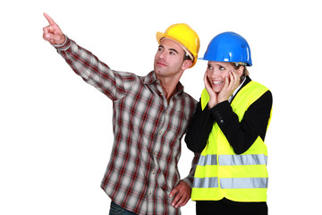 Scared architect stood with builder