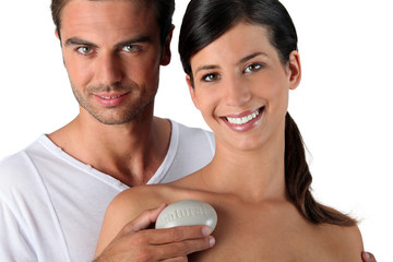 Couple in studio holding pebble