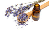 Dried lavender with a bottle of essential oil
