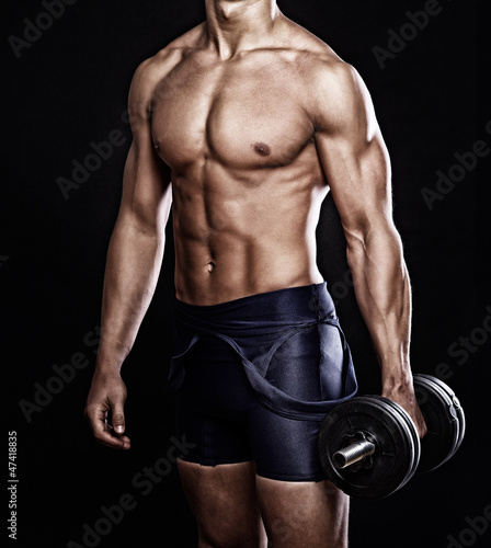 Portrait of handsome man posing on black background