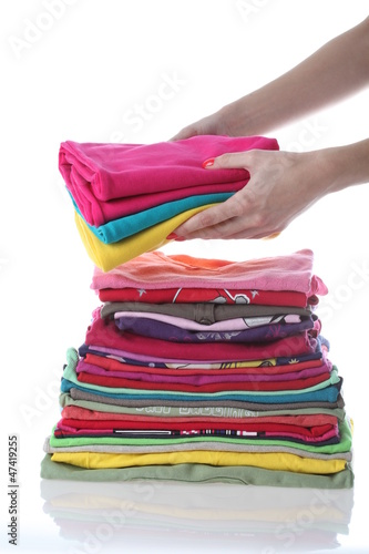 Woman laying down laundry