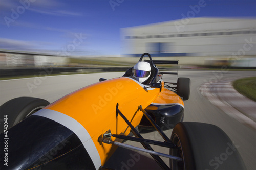 bolide driving at high speed in circuit.Camera on board view bac
