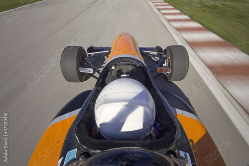 bolide driving at high speed in circuit.Camera on board