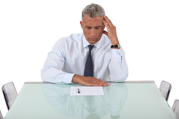 Concentrated man reading a document