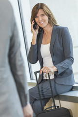 Businesswoman Woman on Cell Phone at Airport