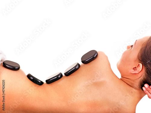Woman getting spa lastone therapy .
