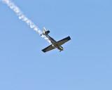 stunt plane trailing smoke poster