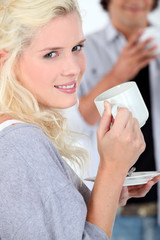 Young woman with a hot drink