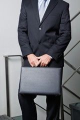 Midsection Of Young Businessman Carrying Briefcase