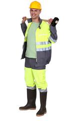 Man holding sledge hammer over shoulder