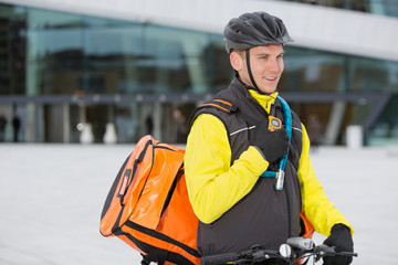 Male Cyclist With Courier Delivery Bag Using Walkie-Talkie