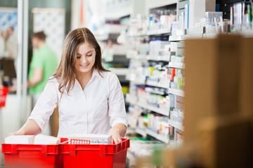 Pharmacist Stocking Shelves in Pharmacy