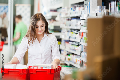 Pharmacist Stocking Shelves in Pharmacy