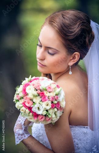shot of a beautiful caucasian bride outdoor