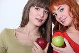 Girls holding apples