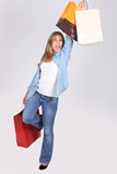 Excited young woman with store bags