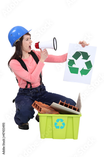 Woman screaming in megaphone with symbol of recycling in hand