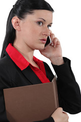 A businesswoman over the phone.