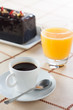 Breakfast with coffee, orange juice and plumcake