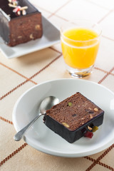 Breakfast with orange juice and plumcake