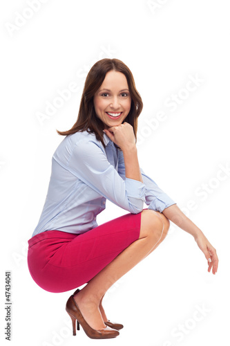 Businesswoman crouching