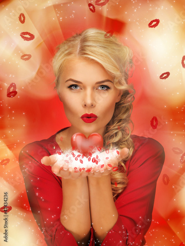 woman blowing kisses on the palms of her hands
