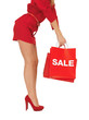woman on high heels holding shopping bag