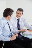 Happy Businessmen In A Meeting