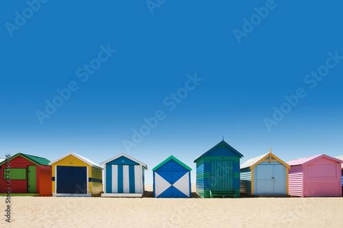 Beautiful bathing houses on white sand beach