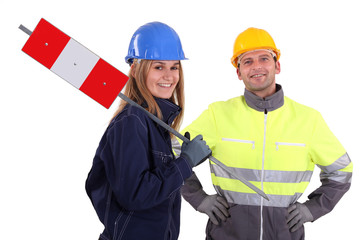 Man and woman construction workers