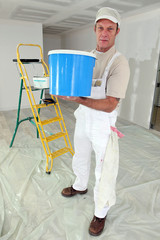 Decorator with a large pot of paint