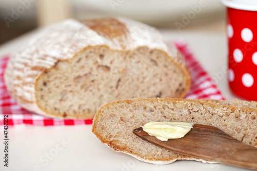 Spelt flour bread slice with butter at breakfast