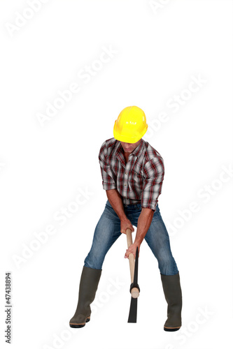 A man using a pickaxe.