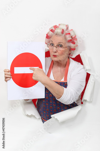 Woman with curlers and no trespassing sign