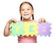 Cute little girl is holding Yes slogan