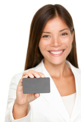 Smiling business woman with blank card